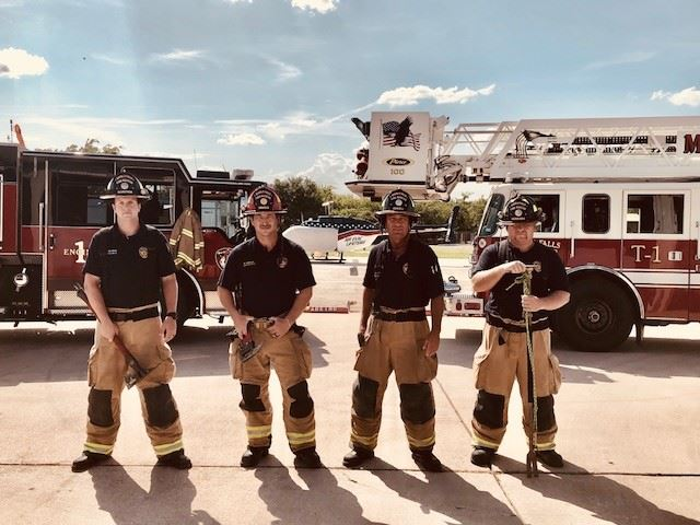 Firefighters of B shift pose with equipment