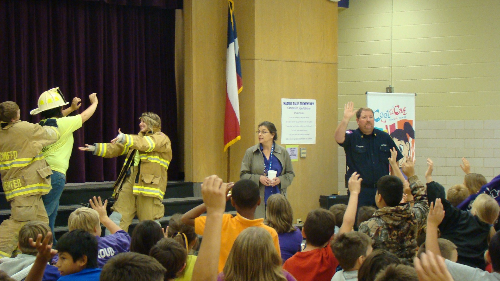Firefighters speak at an event for children